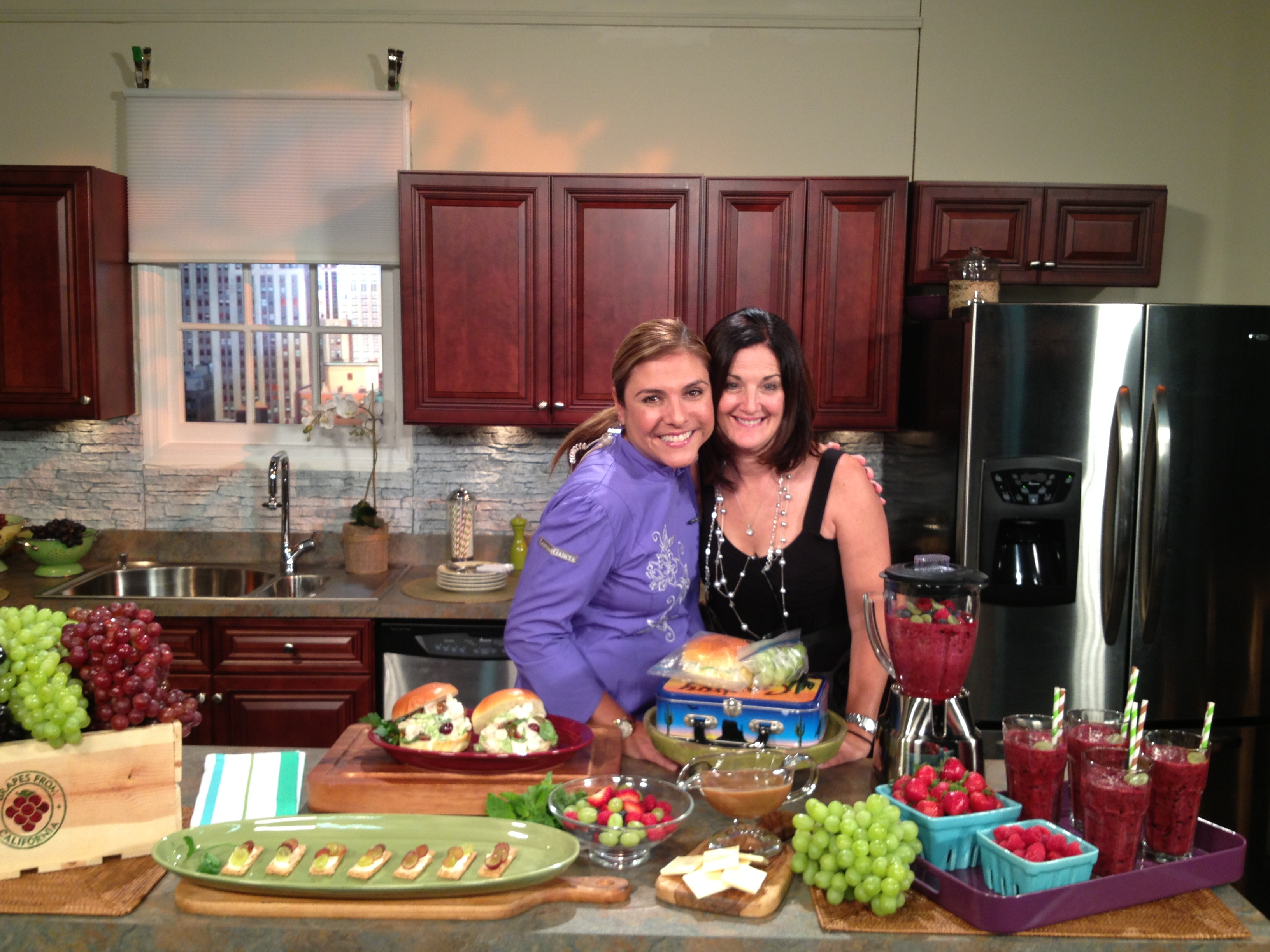 Holland on set with Chef Lorena Garcia